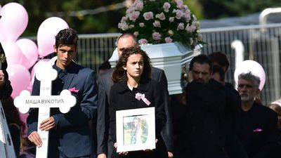 Nadja walked carrying her sister's photo while her brother Petar held a crucifix.  They walked ahead of their sister's white coffin as it entered the Boyd Chapel for the memorial service, trailed by bunches of pink balloons.