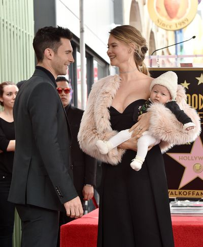 <p>Model Behati Prinsloo and musician Adam Levine, welcomed daughter Dusty Rose Levine in September last year. They are pictured here at the ceremony to honour Adam's star on the Hollywood Walk of Fame in February.</p>