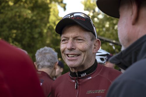 Tony Abbott takes part in the Pollie Pedal Bike Ride in Melbourne this morning. (AAP)