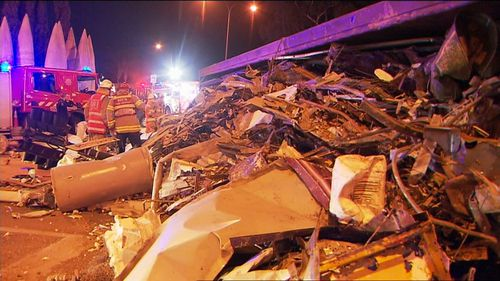 Crews spent much of last night clearing the wreckage. A large amount of scrap metal and old steel was in the truck's load. Picture: 9NEWS