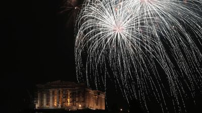 History met the future as fireworks exploded over the Parthenon in Greece. (AFP)