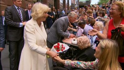 The Duchess of Cornwall receives a posy from a member of the public. (9NEWS)