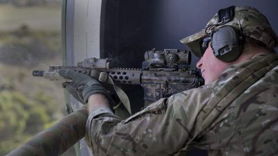 Captain Wales firing on a moving target range with Australian Special Air Service Regiment snipers as part of his Army secondment at Campbell Barracks Swanbourne, Perth.
