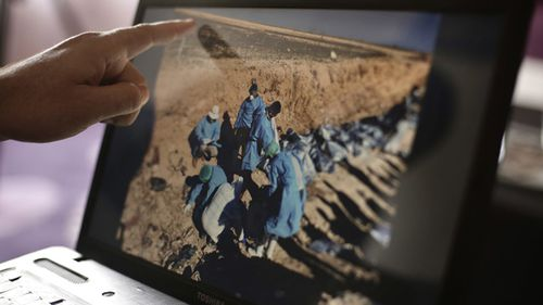 In this May 17, 2016 photo, Sirwan Jalal, Director of Mass Graves for the Kurdish Regional Government, points to an image of the site of a mass grave. UN investigators said today they have verified the location of more than 200 mass grave sites from the time of the Islamic State group€™s reign in northern Iraq, containing the bodies of between 6,000 and 12,000 victims.