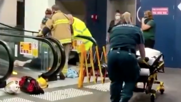 A woman has had to be cut free after becoming caught in an escalator on the Gold Coast, being rushed to hospital after the ordeal.