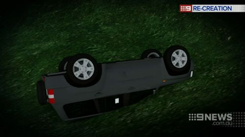 The car's headlights were buried in mud, so the driver used her mobile phone light to alert rescuers. (9NEWS)
