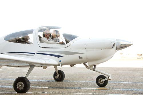 Richard Branson with Virgin Australia cadet pilot Danielle Stokes in Adelaide in 2013. (AAP)