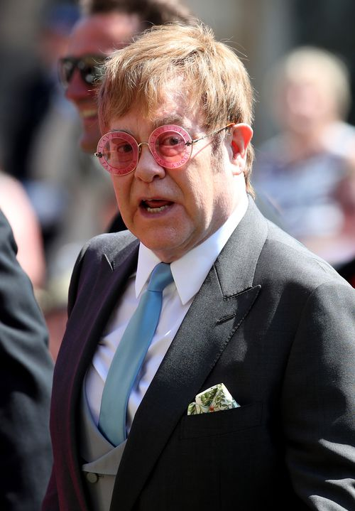Elton John cut a dashing figure as he entered St George's Chapel. Picture: AAP