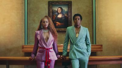 <p >Hot on the heels of their surprise joint album release <em>Everything Is Love,</em> The Carters unleashed the video for the album's lead single, <em>Apes**t</em>, where they took coordinating ensembles to the next level. <br /> <br /> Clad in pastel-coloured his-and-hers suits, the duo romp through the Louvre in Paris in the slick clip directed by Ricky Saiz.<br /> <br /> Beyoncé paired her lavender ensemble with a red sash and a diamond necklace with matching earrings, while Jay Z looked like he was fresh from a screen test for <em>Miami Vice</em> in a mint-green, double-breasted suit with a statement gold chain.</p>