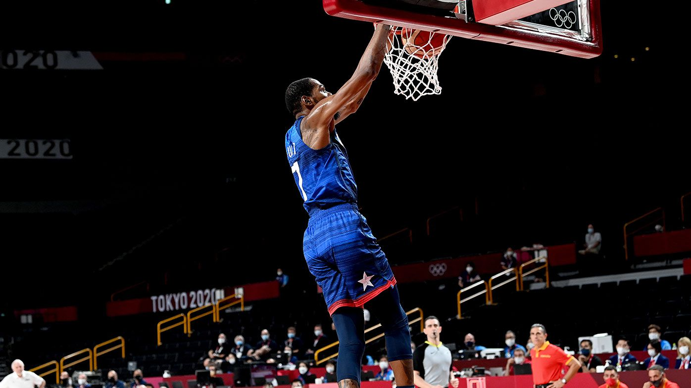 Kevin Durant of the USA slam dunks during the quarter final Basketball match between the USA and Spain on day eleven of the Tokyo 2020 Olympic Games at Saitama Super Arena on August 03, 2021 in Saitama, Japan. (Photo by Bradley Kanaris/Getty Images)