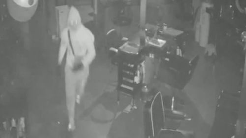 One of the thieves can be seen inside the salon.
