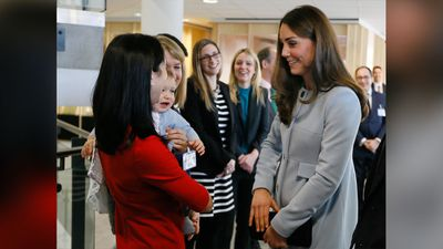 The Duchess of Cambridge meets Rosie Benson and her son Zach who burst into tears when Kate arrived. (AAP)