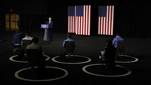 Joe Biden addresses a socially distanced audience.