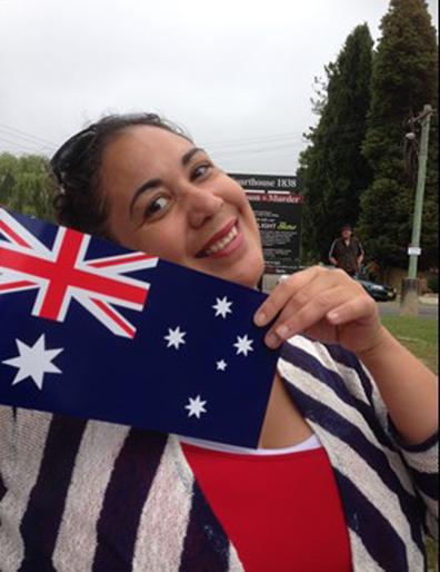 Kathryn Heaven holding an Australian flag