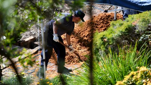 Police dig at the former Dawson home today.