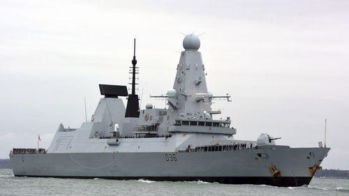 Russia says warning shots deter UK warship; London denies it