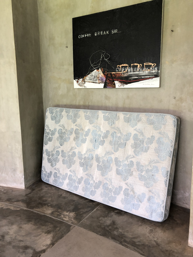 Dirty, old mattress in Bali home.