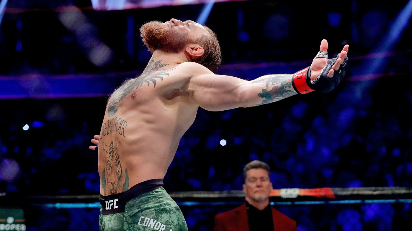 Conor McGregor reacts before taking on Donald Cerrone in their welterweight bout