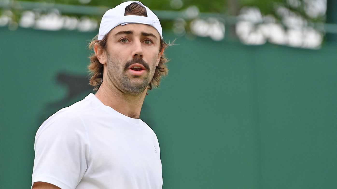 Jordan Thompson of Australia plays a forehand in his Men's Singles First Round match against Casper Ruud