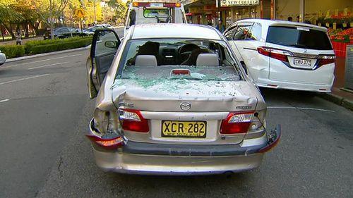 Two people injured after car smashed into Sydney shop