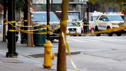 An area cordoned off with police tape after a shooting near Fountain Square in downtown Cincinnati.