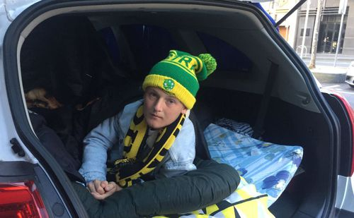 One fan slept overnight in a car while taking shifts waiting in line for tickets.