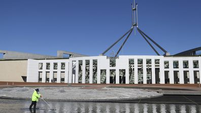 A cleaner working on the forecourt of Parliament House in Canberra.