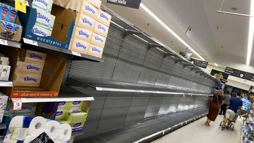 An empty aisle in the St Ives, Woolworths store, where the toilet paper should be.