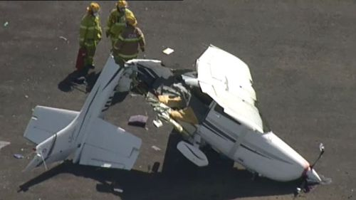 A light plane has been destroyed after clipping another when landing. (9NEWS)