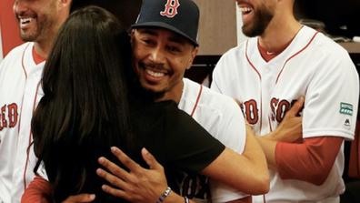 Meghan meets cousin at the baseball