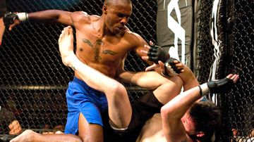 Cedric Marks (blue) punches Brandon McDowell during the Xtreme Fight Championship Texas Battle Grounds Warzone Series in 2009.