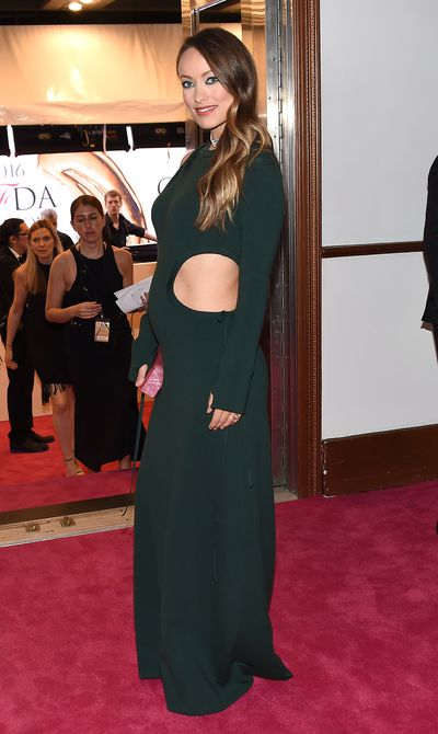 <p>Olivia Wilde's stylist Karla Welch suggests looking for non-maternity pieces that can be nipped in under the bust or bump.</p>