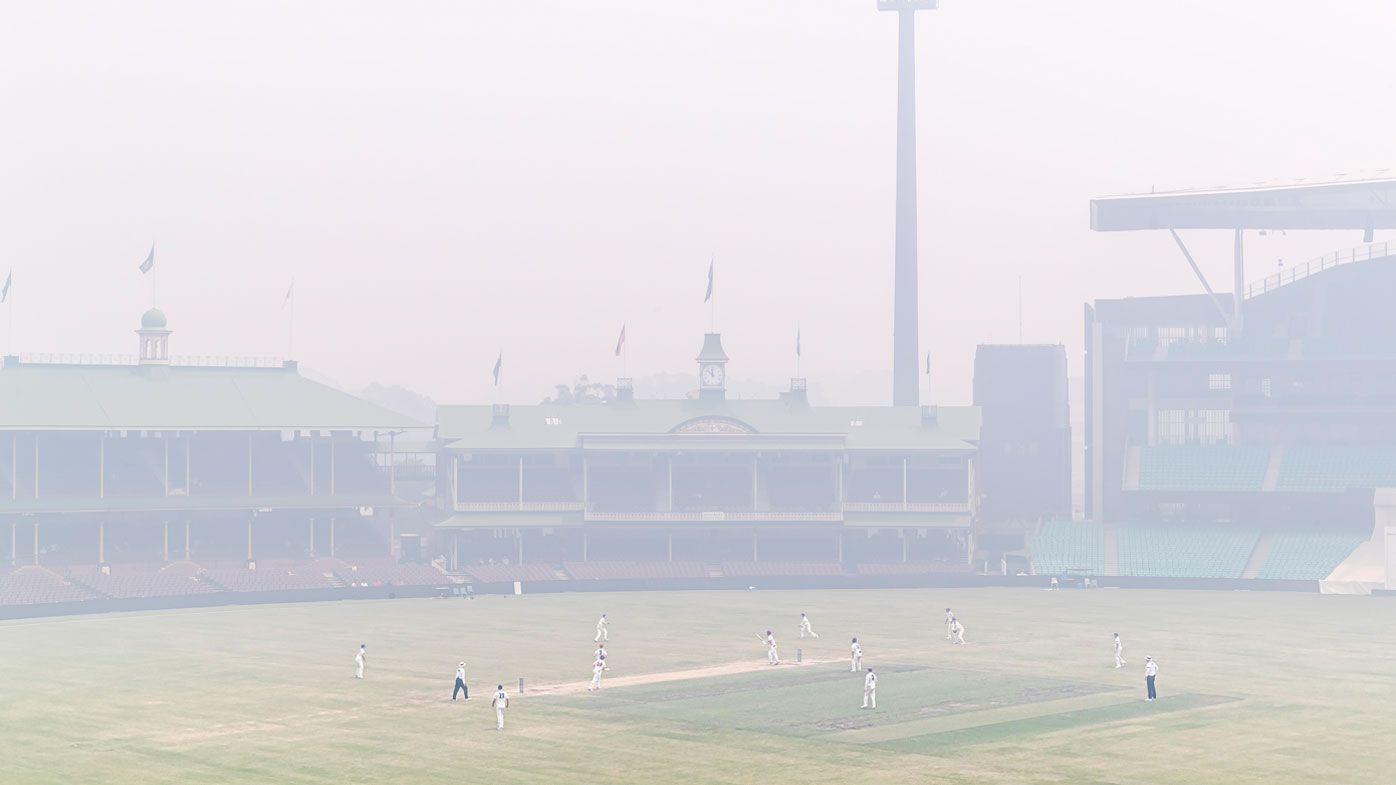 Smoke smothers the SCG during a Shield match