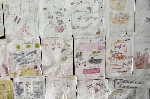 drawings by former child soldiers displayed at the Rehabilitation Of Children Recruited and Impacted By War in Yemen Project center, in Marib.