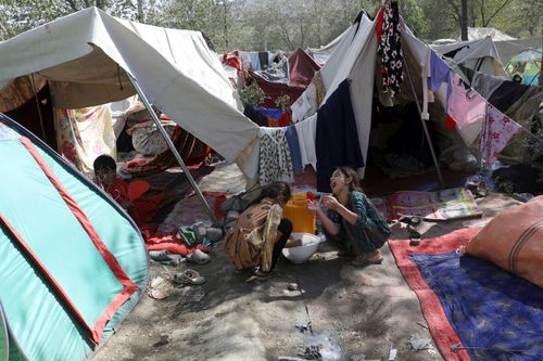 Internally displaced Afghans from northern provinces, who fled their home due to fighting between the Taliban and Afghan security personnel, take refuge in a public park in Kabul.