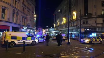 Two people have been injured after a stabbing attack outside a busy department store in the UK overnight.
