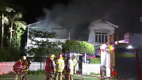 Fire guts inner-Brisbane Queenslander, threatened neighbours