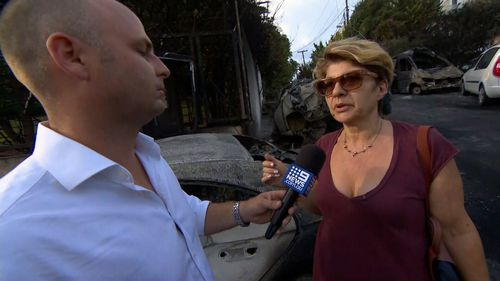 Lea Olympiou were forced to wait for hours in the sea as the fires burned. Picture: 9NEWS