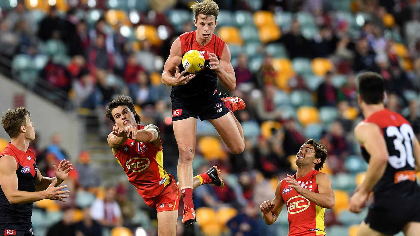 Demons smash Suns in dull Gabba AFL affair