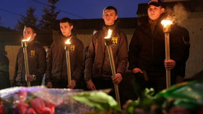 Ukrainian volunteers battalion servicemen hold torches during a outside the Belgium embassy in Kiev. (AFP)