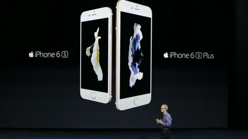 Apple CEO Tim Cook shows off the new IPhone 6S and 6S Plus.