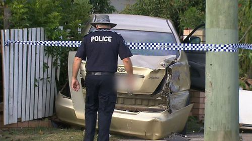 A Queensland runner has been killed while on a jog after an out-of-control car left a Beenleigh road and pinned her to a fence.