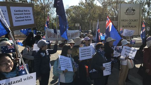 Supporters of George Pell outside the High Court in Canberra.