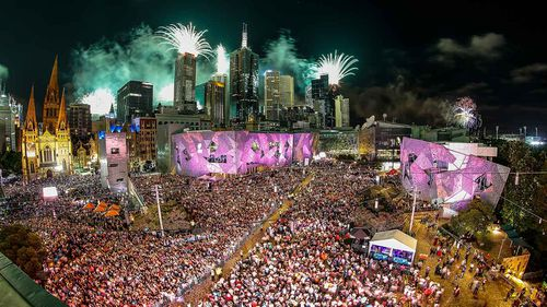 People enjoying the celebrations at Federation Square during the New Year's Eve celebrations on December 31, 2016 in Melbourne.