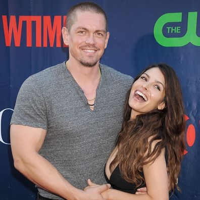Sarah Shahi and Steve Howey arrives at the CBS, CW And Showtime 2015 Summer TCA Party at Pacific Design Center on August 10, 2015 in West Hollywood, California.