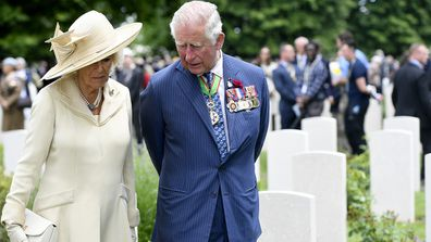 Charles and Camilla walk through the Commonwealth War Graves cemetery as part of D-Day celebrations, Thursday June 6, 2019.