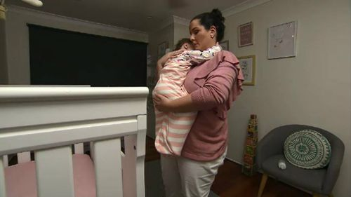 Sara Humphries settles her daughter Layla. Picture: 9NEWS