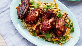 Red roasted crispy skinned chicken with long life noodles