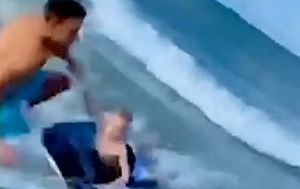 Off-duty police officer saves boy from shark just metres away