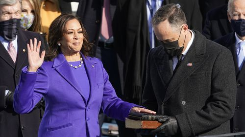 Kamala Harris is sworn in as vice president by Supreme Court Justice Sonia Sotomayor as her husband Doug Emhoff holds the Bible during the 59th Presidential Inauguration at the U.S. Capitol in Washington, Wednesday, Jan. 20, 2021. (AP Photo/Andrew Harnik)
